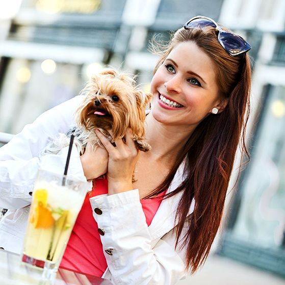 Woman enjoying a drink with her dog